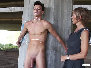 Nympho granny sucks a big load of shit of plighted naked guy